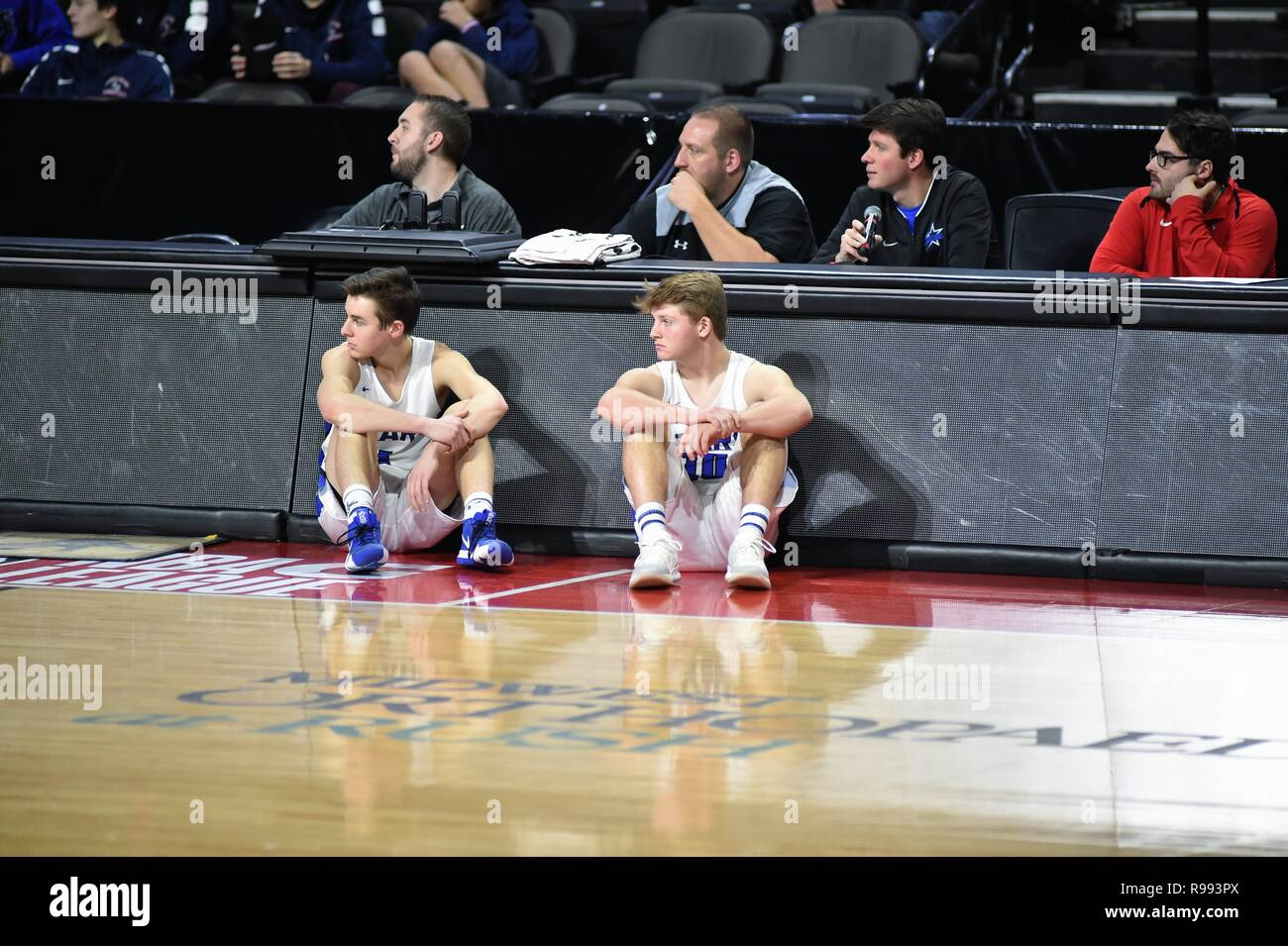 After checking in a the scorer's table, players sit while waiting to enter the game during the next pause in play. - Stock Image