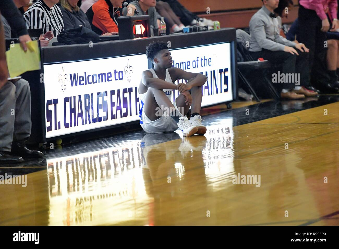 After checking in a the scorer's table, player waits to enter the game during the next pause in play. - Stock Image