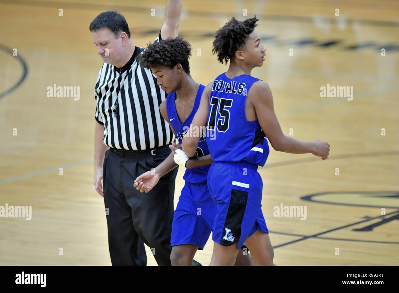 During a timeout a substitute player replaces a teammate on the court. - Stock Image