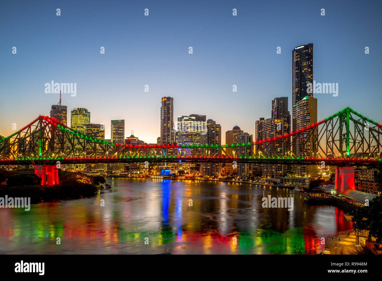 brisbane with story bridge in australia at night - Stock Image