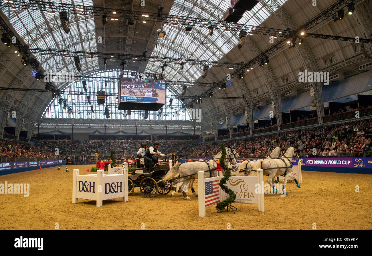 Great Britain's Daniel Naprous competes in the FEI Driving World Cup leg during day five of the London International Horse Show at London Olympia. - Stock Image