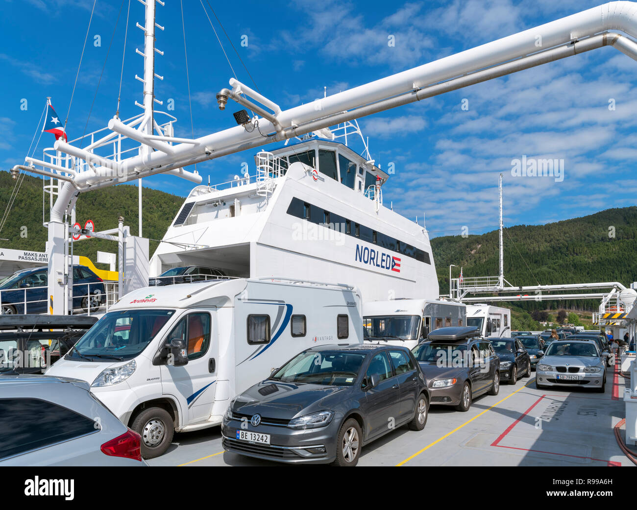 Cars and camper vans on the Lavik to Ytre Oppedal ferry (route E39), Sognefjord, Sogn og Fjordane, Norway - Stock Image