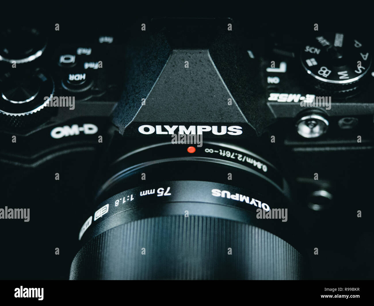Close up of black Olympus OM-D EM 5 camera with cooler blue green midtones - Stock Image