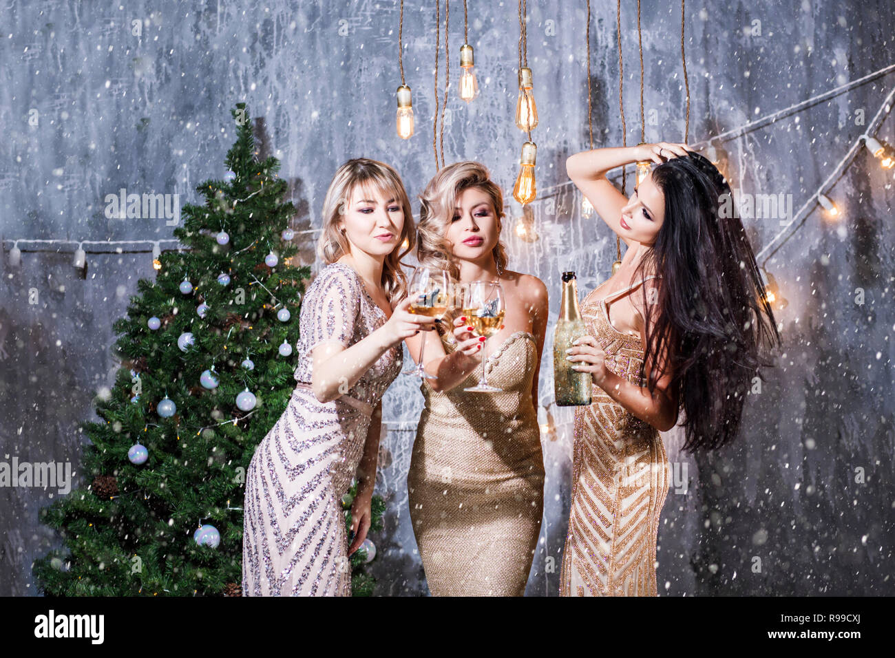 Christmas Evening Party.Three Beautiful Girls On The New Year S Eve Party Drinks