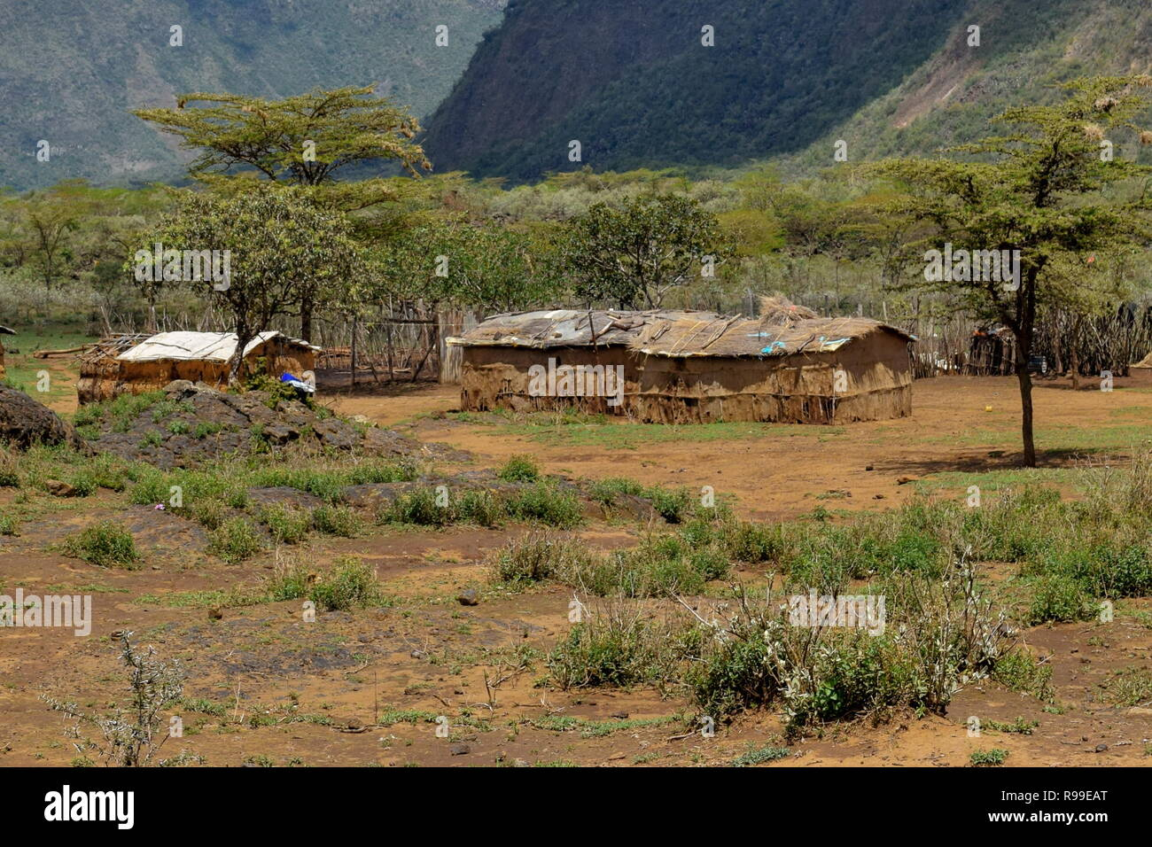 Traditional Masai homesteads at the foothills of Mount Suswa, Rift Valley, Kenya Stock Photo