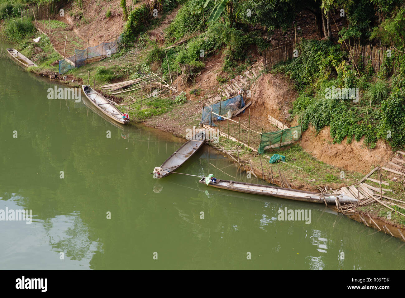 boats on the Namkading River in Laos by Tha Bak made out of drop tanks from US bombers - Stock Image