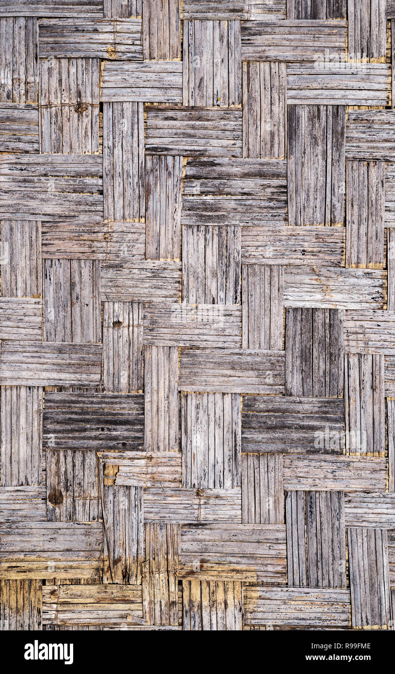 old gray distressed grunge bamboo mat background texture - Stock Image