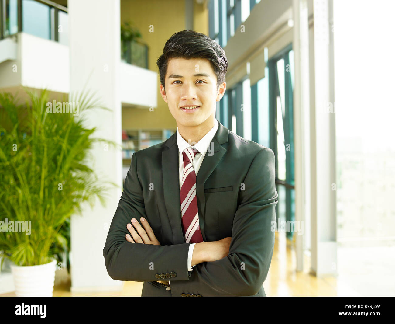 Portrait Of A Young Asian Business Man Arms Crossed