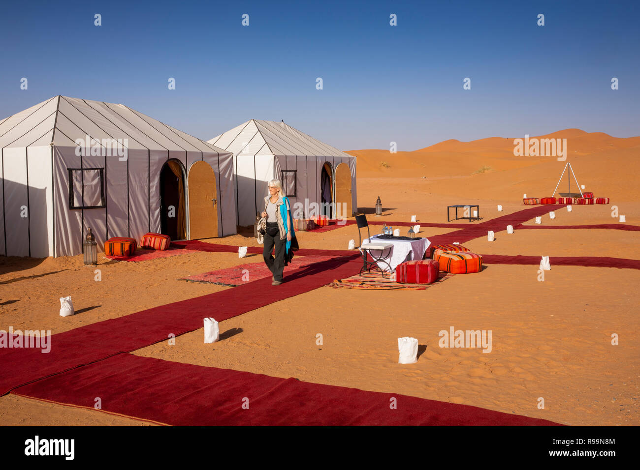 Morocco, Errachidia Province, Erg Chebbi, woman in luxury desert camp inside sand dunes, Stock Photo