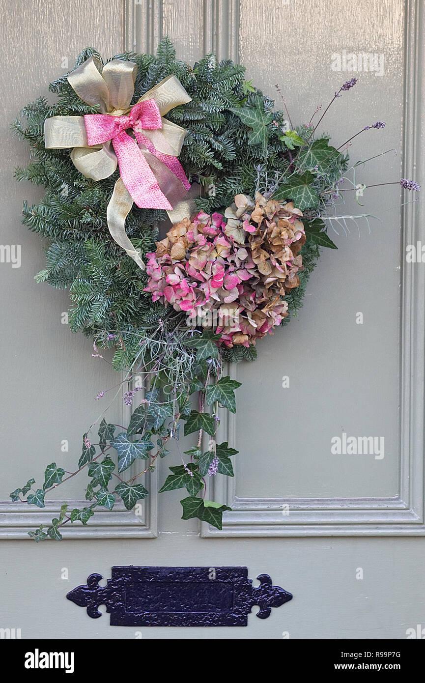 Christmas wreath on a wooden door Stock Photo