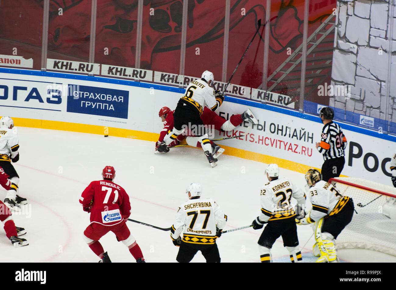 PODOLSK, RUSSIA - OCTOBER 16, 2018: V. Vasilyev (6) fault on A. Syomin (28) during hockey game Vityaz vs Severstal on Russia KHL championship on October 16, 2018, in Podolsk, Russia. Vityaz won 4:1 Stock Photo