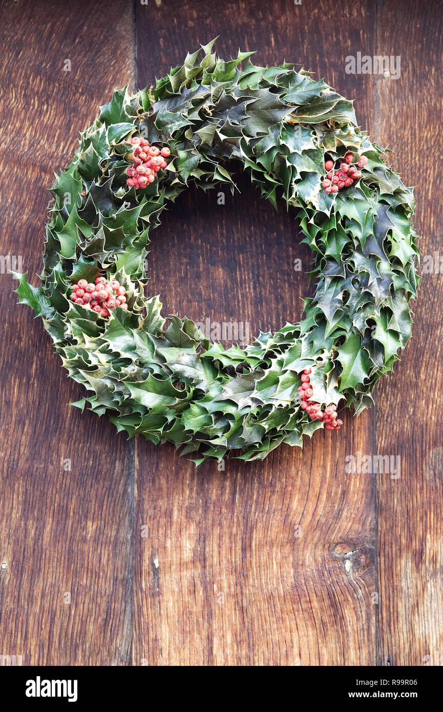 Christmas wreath on a wooden door Stock Photo