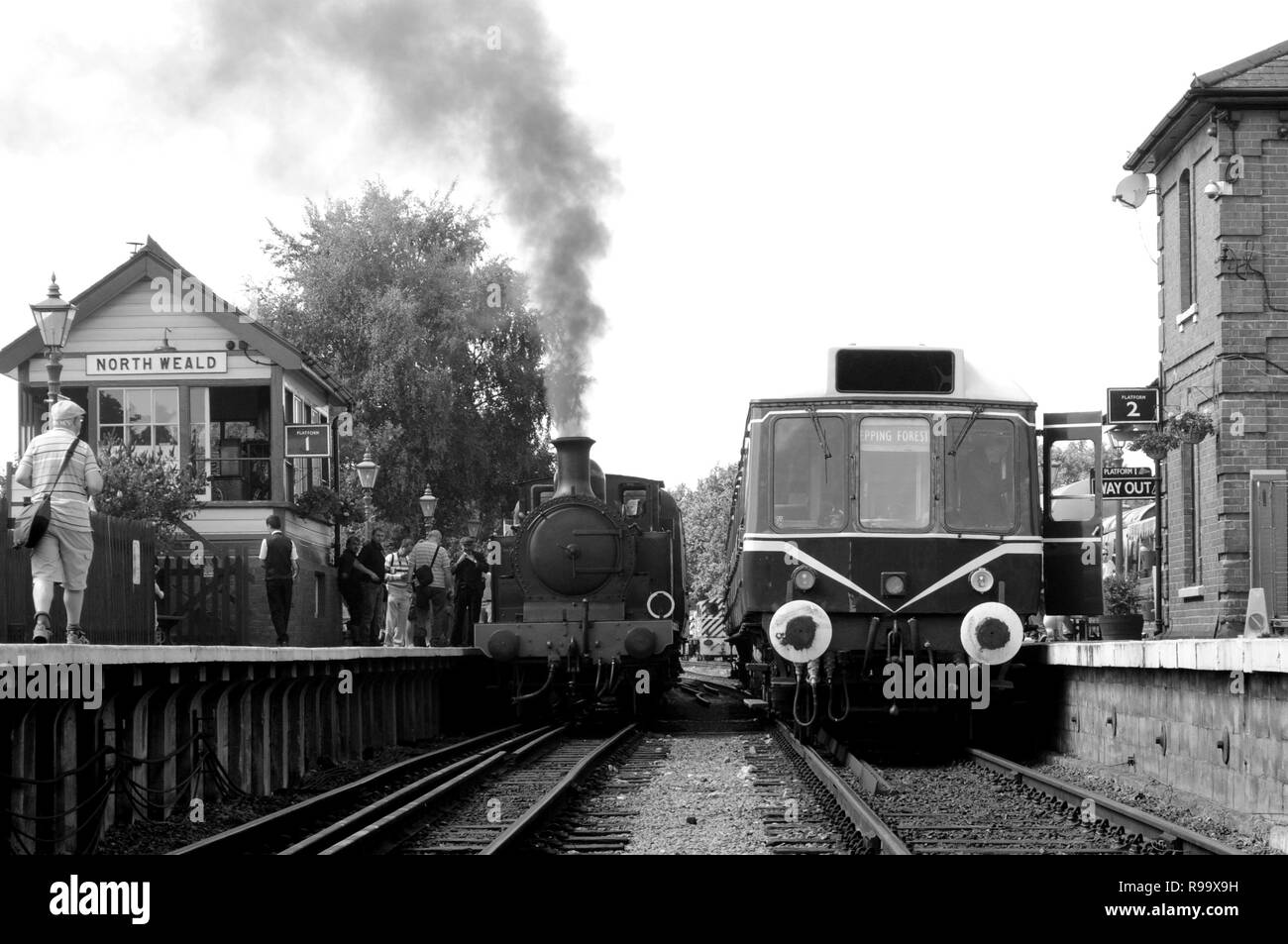 1898 Metropolitan Railway E Class 'Metropolitan Railway No.1' (l) and Class 117 DMU M51384 (r) at North Weald Station, Epping Ongar Railway, Essex, UK. - Stock Image