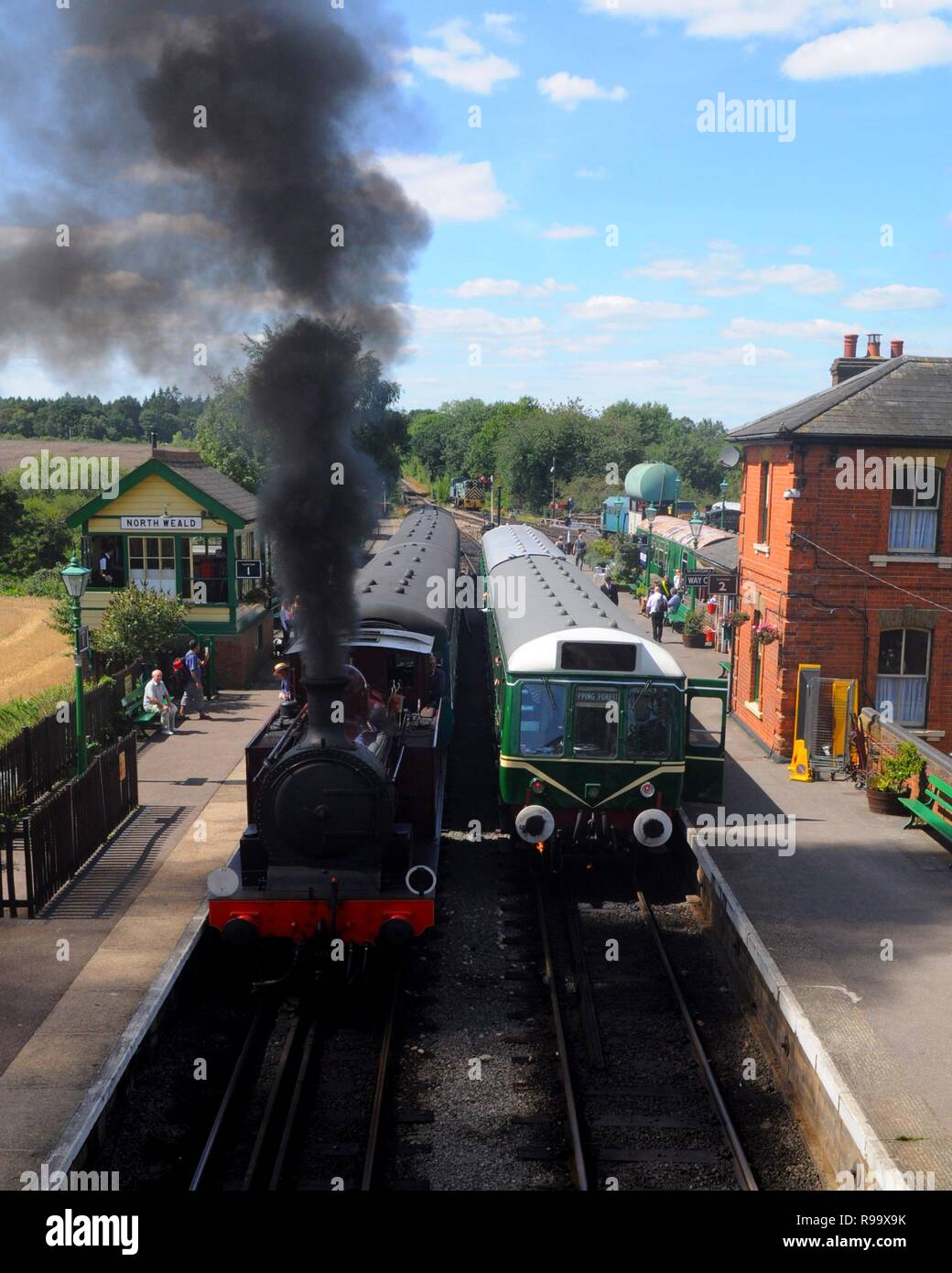 1898 Metropolitan Railway E Class 'Metropolitan Railway No.1' (l) and Class 117 DMU M51384 (r), North Weald Station, Epping Ongar Railway, Essex, UK. - Stock Image