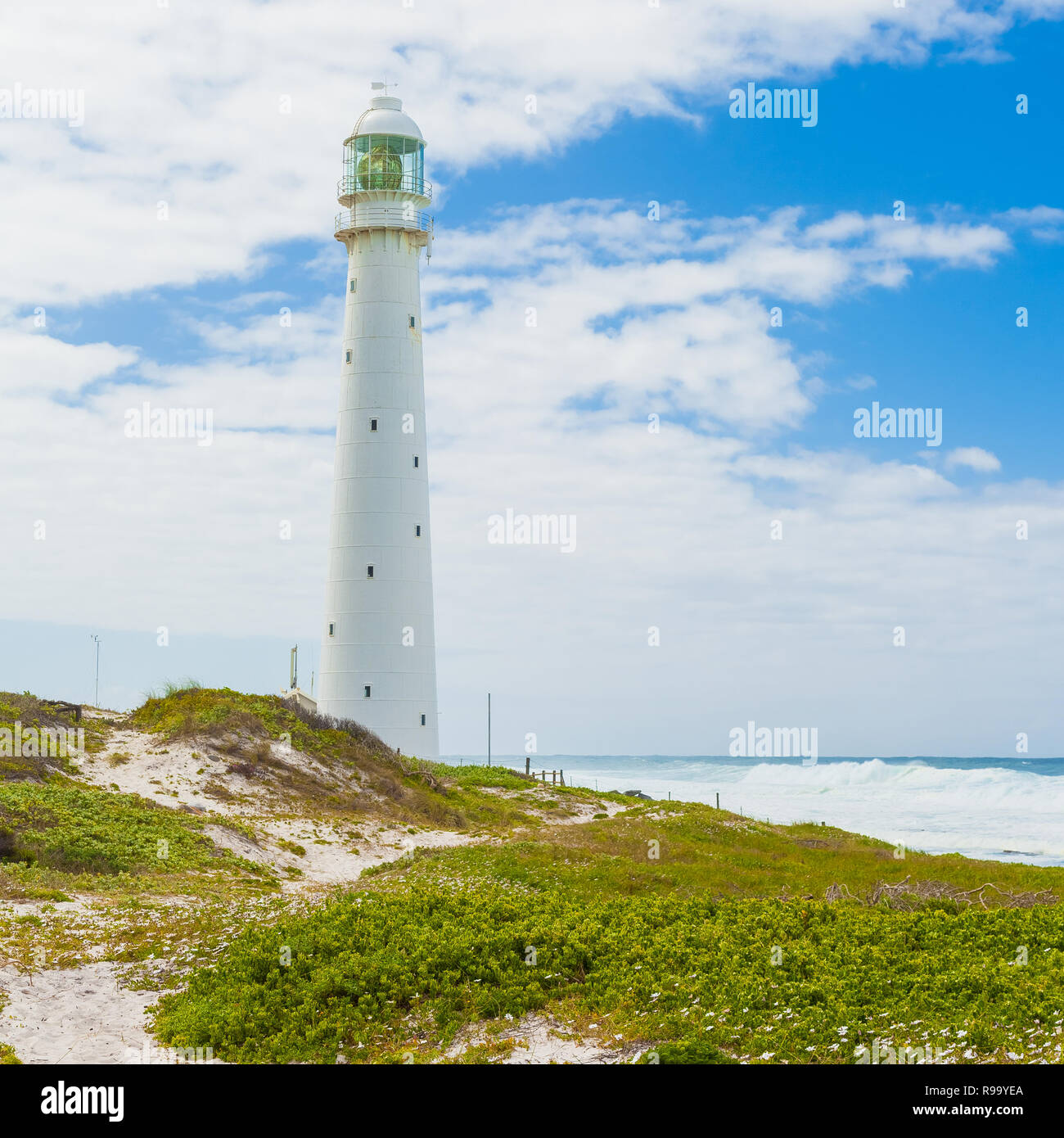 Lighthouse on the rugged Cape Town South Africa coastline during the day - Stock Image