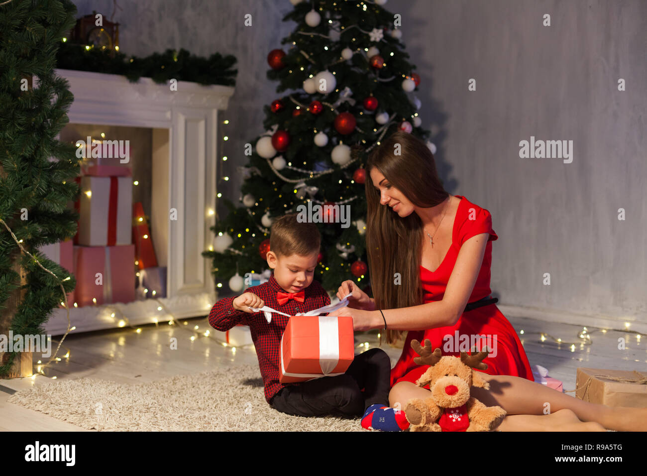 Mother Christmas.Mother And Son Open Gifts Christmas New Year Holiday Garland