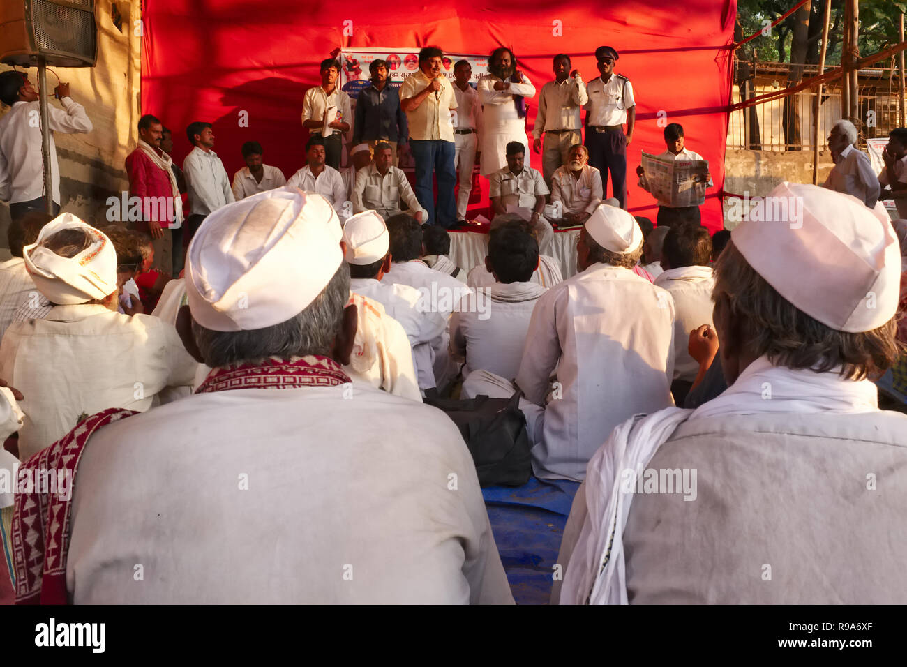 Impoverished farmers from Maharashtra state attending a political rally at Azad Maidan, Mumbai, India, a popular rallying point in the city - Stock Image