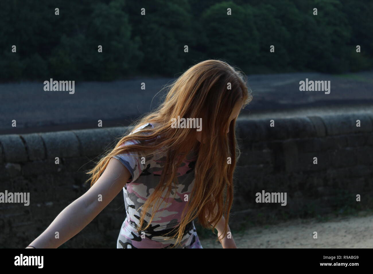 10 year old girl, long ginger hair - Stock Image