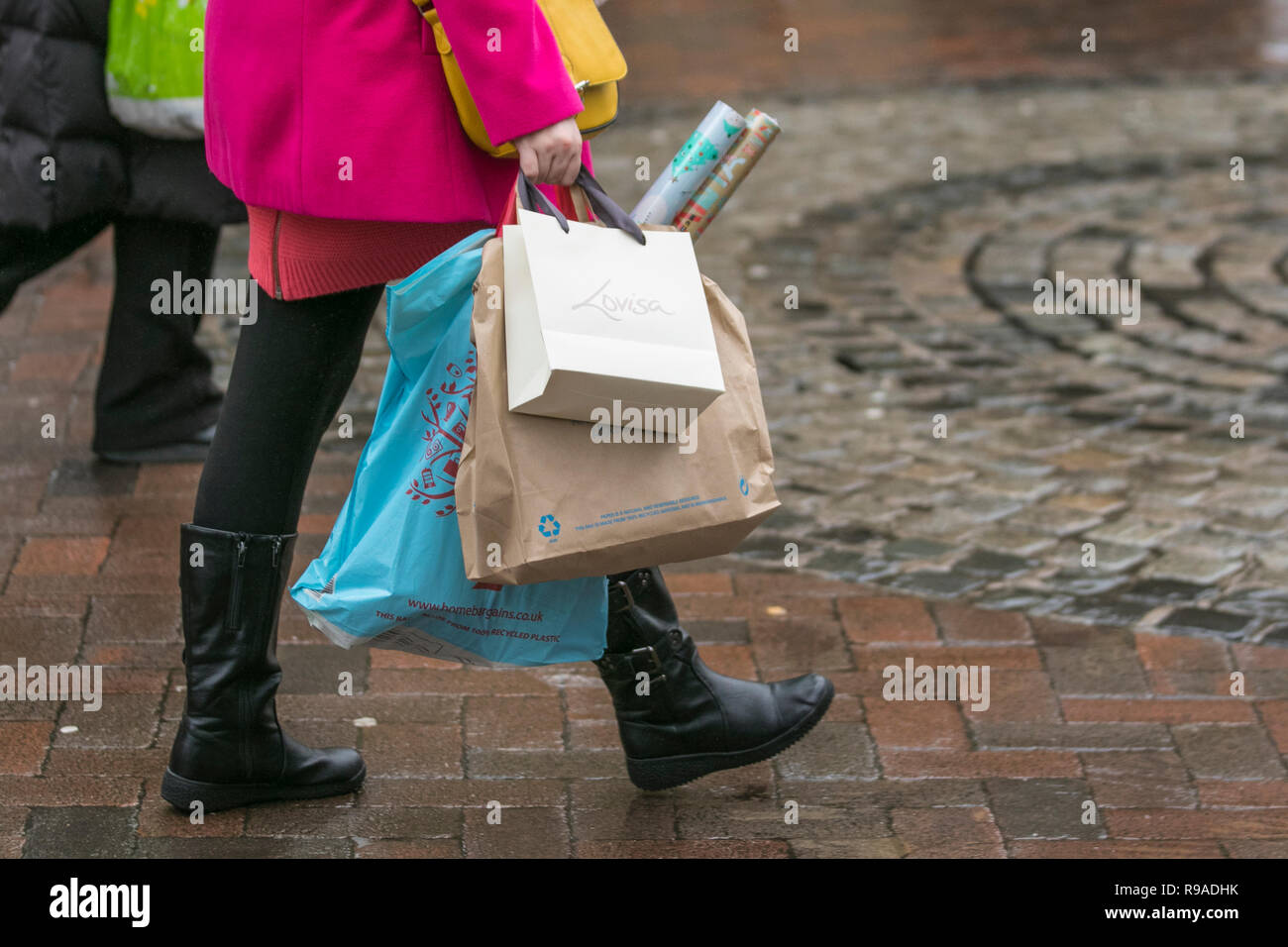 Preston, Lancashire.  21st Dec. UK Weather. Wet & windy day for Christmas shoppers as the sale signs go up in retail outlets discounting items across the store in an attempt to stimulate festive high street sales. Credit: MediaWorldImages/Alamy Live News - Stock Image