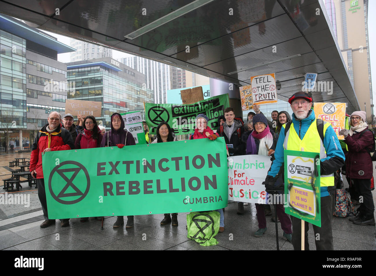Salford, UK. 21st Dec, 2018. Extinction Rebellion campaigners gather to hold a protest outside the BBC to convey their concerns of the climate and ecological emergency and demand urgent action. The campaigners said they are 'calling on the BBC, as a respected media voice in the UK, to play a key role in the change needed'. BBC, Media City, Salford, UK, 21st December 2018 (C)Barbara Cook/Alamy Live News Credit: Barbara Cook/Alamy Live News - Stock Image