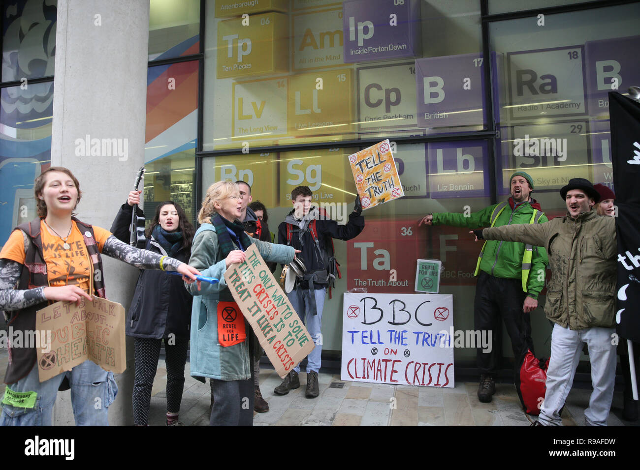 Salford, UK. 21st Dec, 2018. Extinction Rebellion campaigners hold a protest outside the BBC to convey their concerns of the climate and ecological emergency and demand urgent action. The campaigners said they are calling on the BBC, as a respected media voice in the UK, to play a key role in the change needed'. BBC, Media City, Salford, UK, 21st December 2018 (C)Barbara Cook/Alamy Live News Credit: Barbara Cook/Alamy Live News - Stock Image