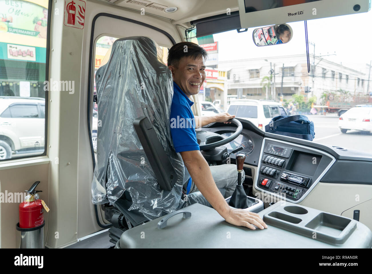22/12/2018 Cebu City,Philippines.Driver of a new style modern Jeepneys deployed on the roads of Cebu City.Locally known as a 'Beep' they have a seating capacity of 24 passengers, and can accommodate an additional 10 standing. Each is equipped with free wifi, dashcam, and a closed circuit television (CCTV) camera.Starting in January 2018 the Department of Transportation (DOTr) in the Philippines started to remove jeepneys older than 15 years  as part of the government's transport modernization program. - Stock Image