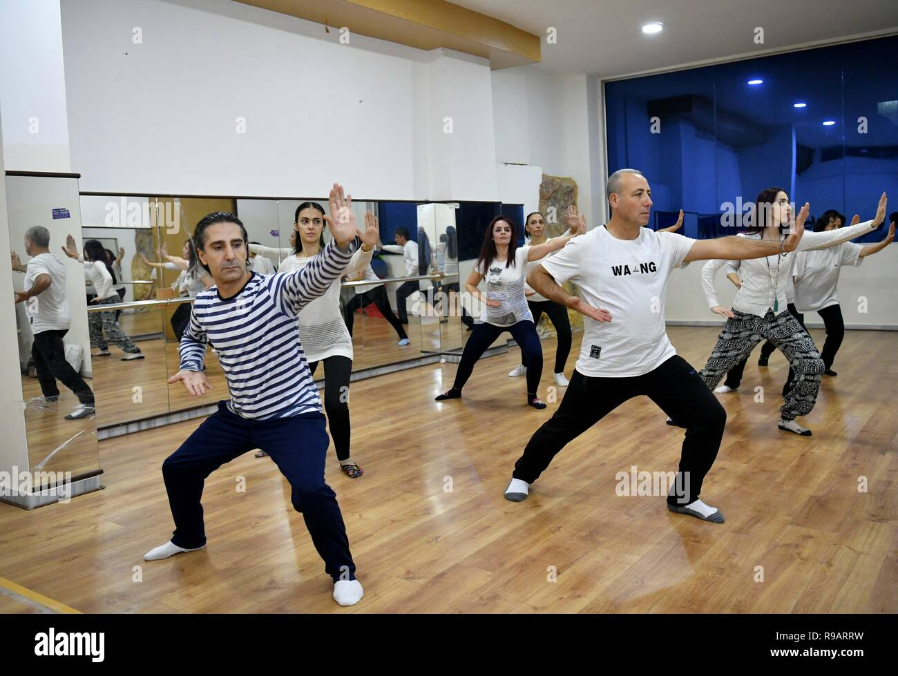 Damascus. 13th Dec, 2018. A group of Syrians practice Tai Chi in Damascus, Syria, Dec.13, 2018. TO GO WITH Feature: Syrians find escape from stressful war by practising Tai Chi. Credit: Ammar Safarjalani/Xinhua/Alamy Live News - Stock Image