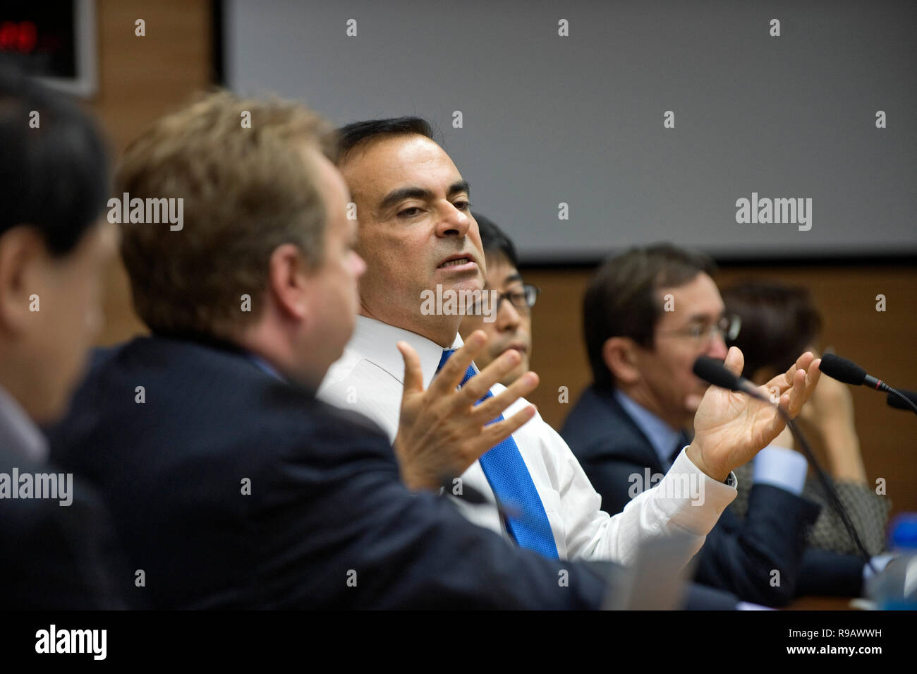 Carlos Ghosn, former president and CEO of Nissan Motor Co., speaks during an executive meeting at the automaker's HQ in Yokohama, Kanagawa Prefecture, - Stock Image