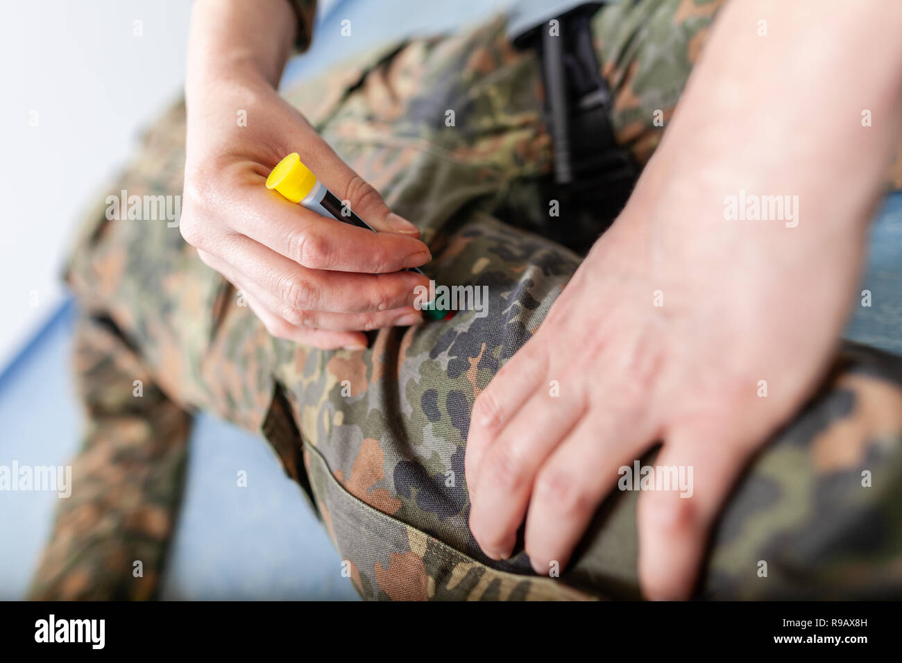 German soldier injections a morphin auto injector - Stock Image