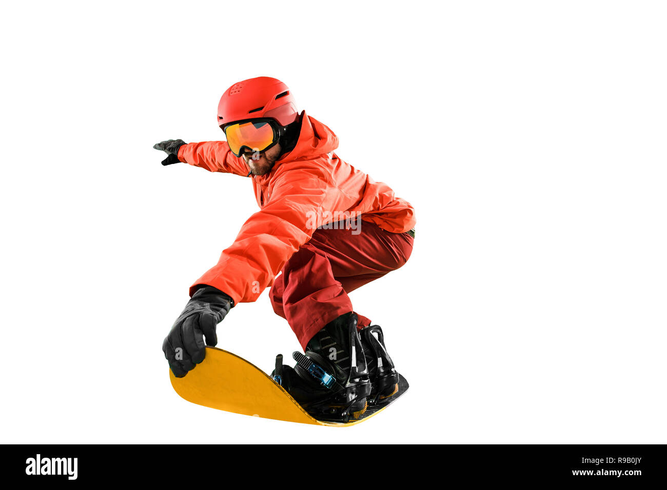 Portrait of young man in sportswear with snowboard isolated on a white studio background. The winter, sport, snowboarding, snowboarder, activity, extreme concept - Stock Image