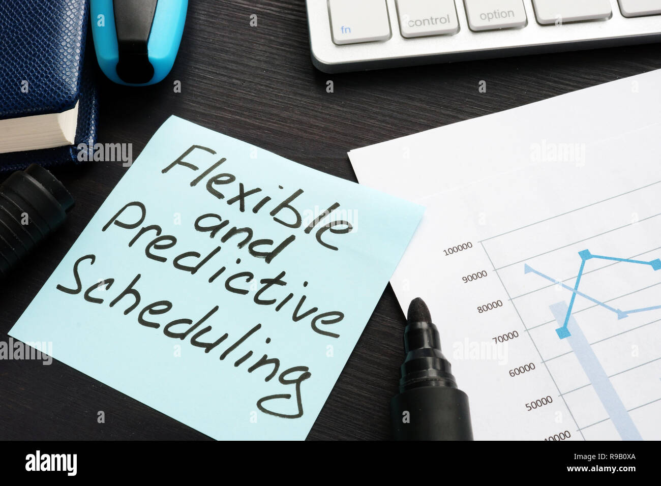 Flexible and Predictive Scheduling written on a memo stick. - Stock Image