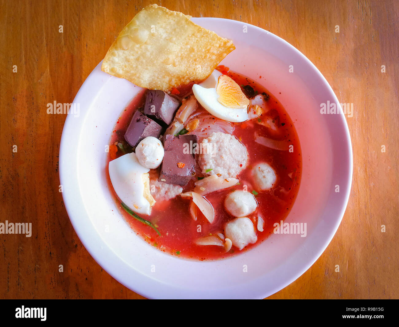 noodles with seafood on red soup / hot and spicy thai food