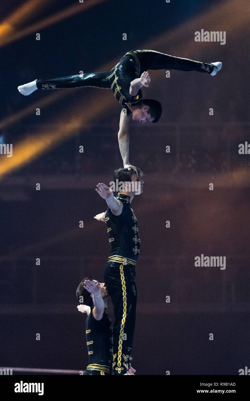 Noam Patel, Robin Casse, Jonas Anthoon and Hanees Garré performing a men's group acrobatics exercice during the yearly gymgala, organised by Gymnastie - Stock Image