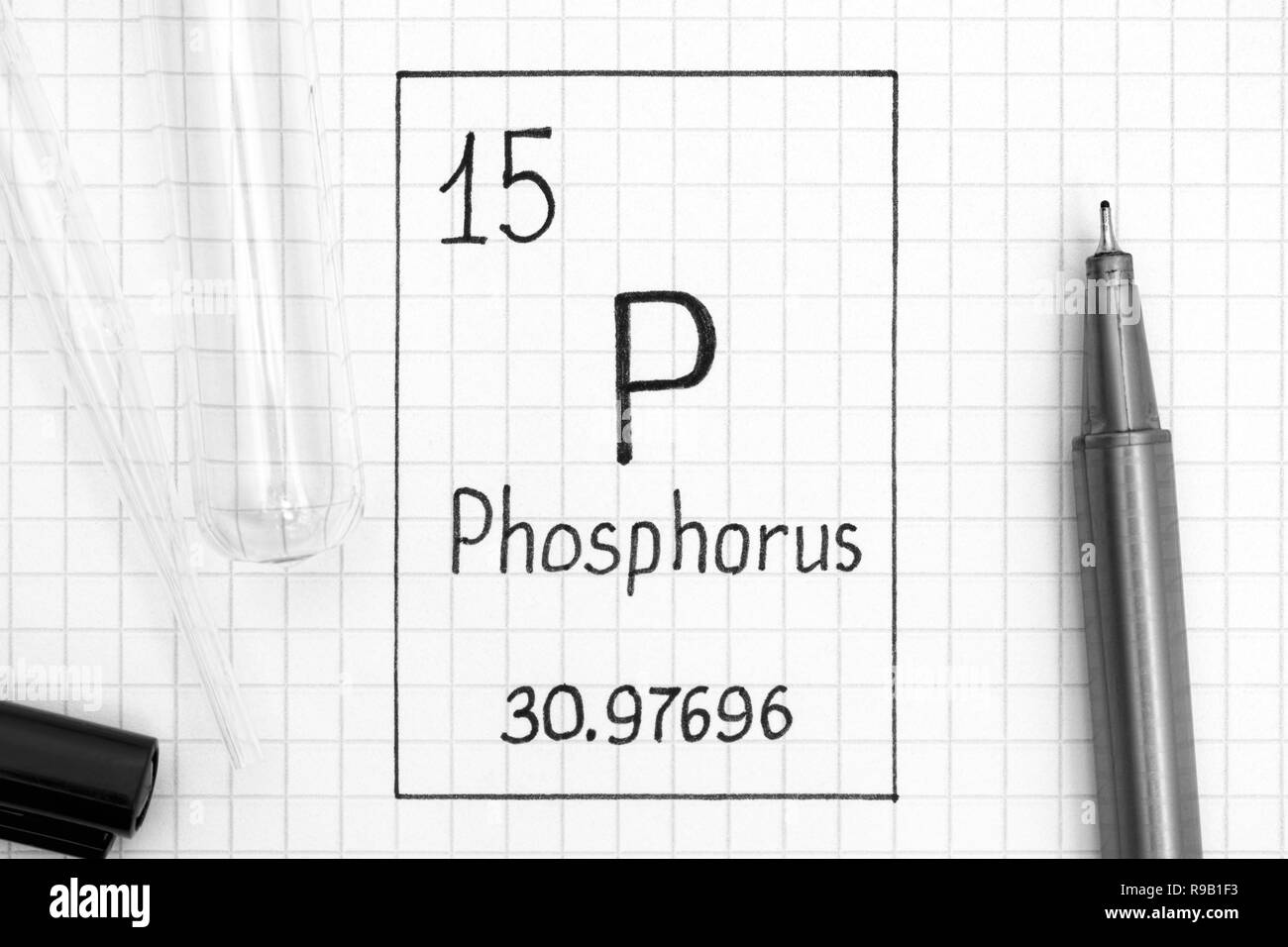 The Periodic table of elements. Handwriting chemical element Phosphorus P with black pen, test tube and pipette. Close-up. - Stock Image