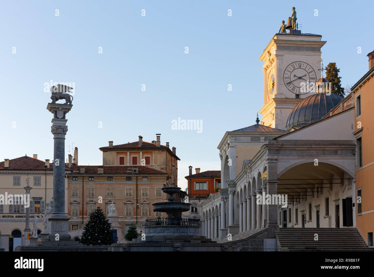 Libertà square in Udine, Italy, during a Christmas time sunset, seen from Vittorio Veneto street - Stock Image