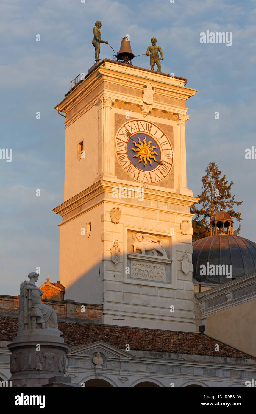 Clock Tower during a winter sunset in Udine, Italy - Stock Image