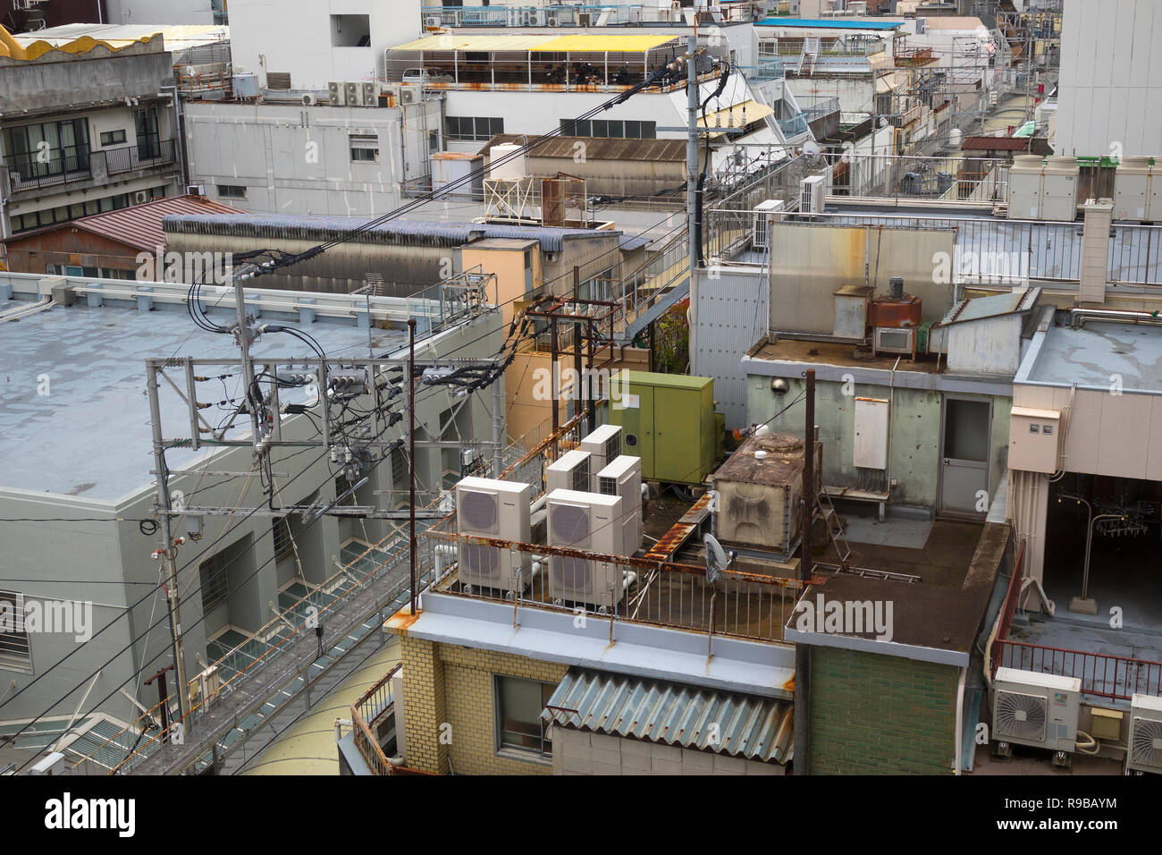 Nagasaki, Japan - October 23, 2018:  View over the roofs of houses with air conditioning boxes, watertanks and electricity connections - Stock Image