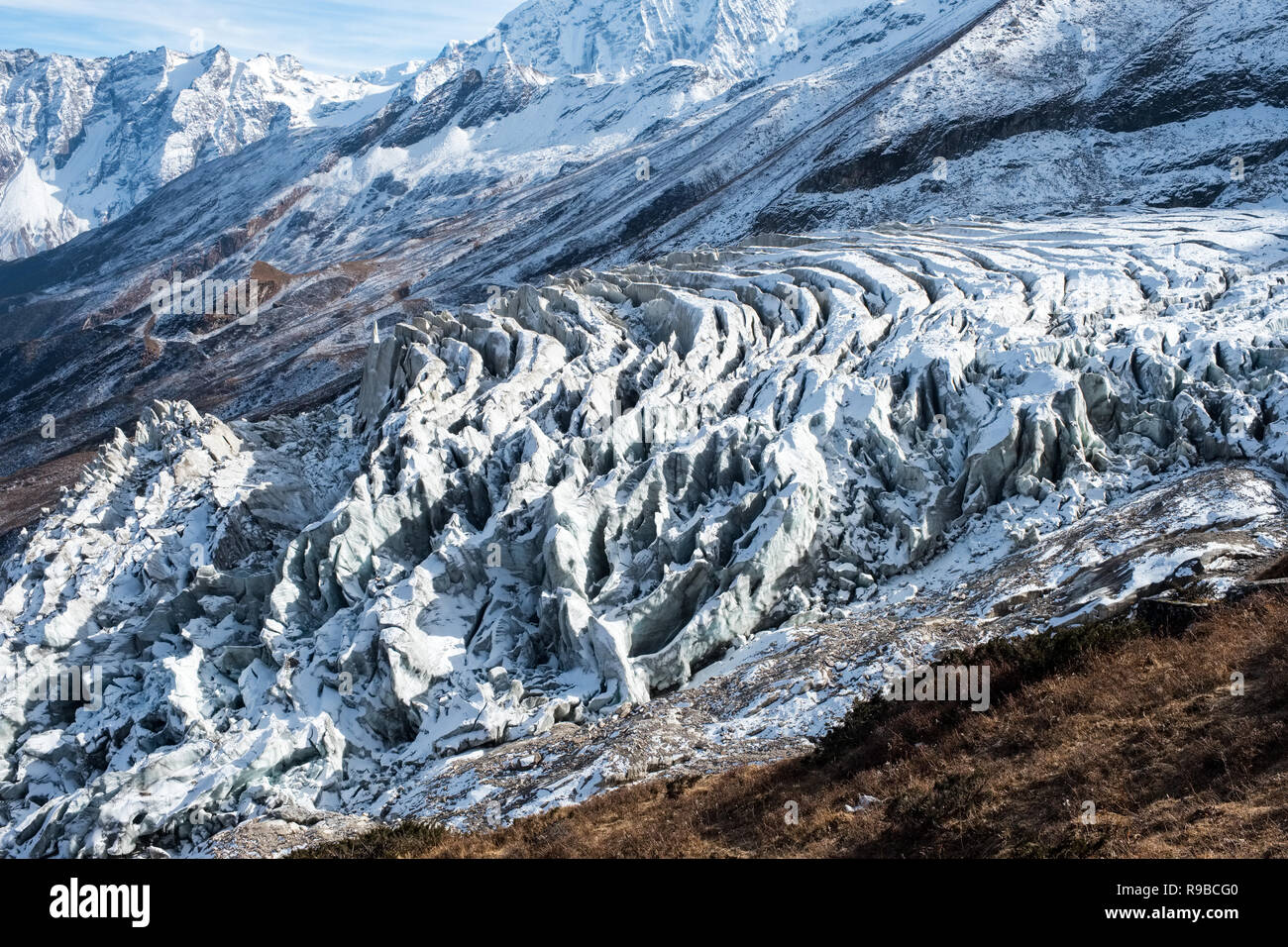 Seracs and crevasses on the glacier coming down from Manaslu in the Nepal Himalayas - Stock Image