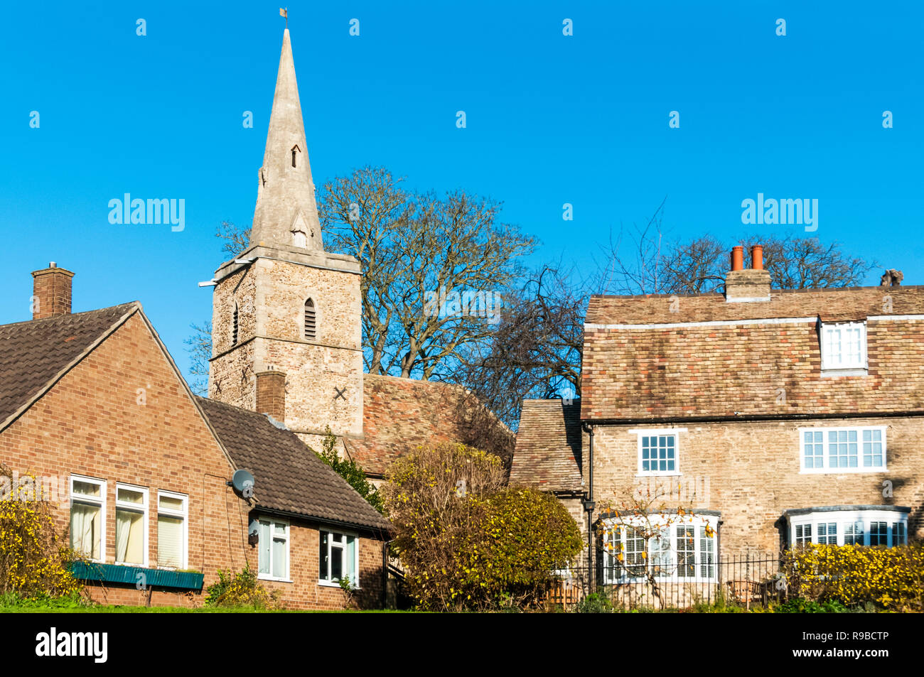 The redundant St Peter's church, Cambridge behind the buildings of Kettle's Yard. - Stock Image