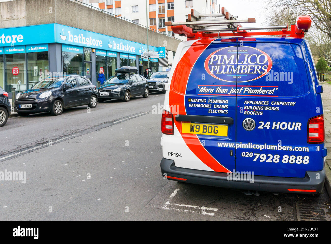 A Pimlico Plumbers van with a plumbing-related number plate. - Stock Image