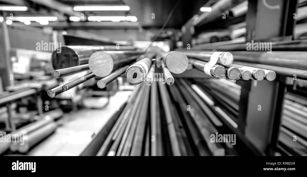 Steel Rod Stock in a manufacturing plant - Stock Image