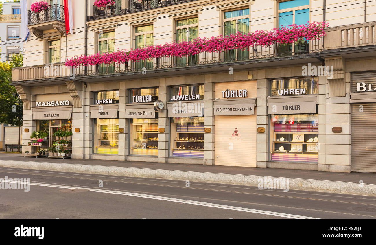 Zurich, Switzerland - July 30, 2016: stores on Bahnhofstrasse street in the city of Zurich. Bahnhofstrasse is Zurich's main downtown street and one of - Stock Image