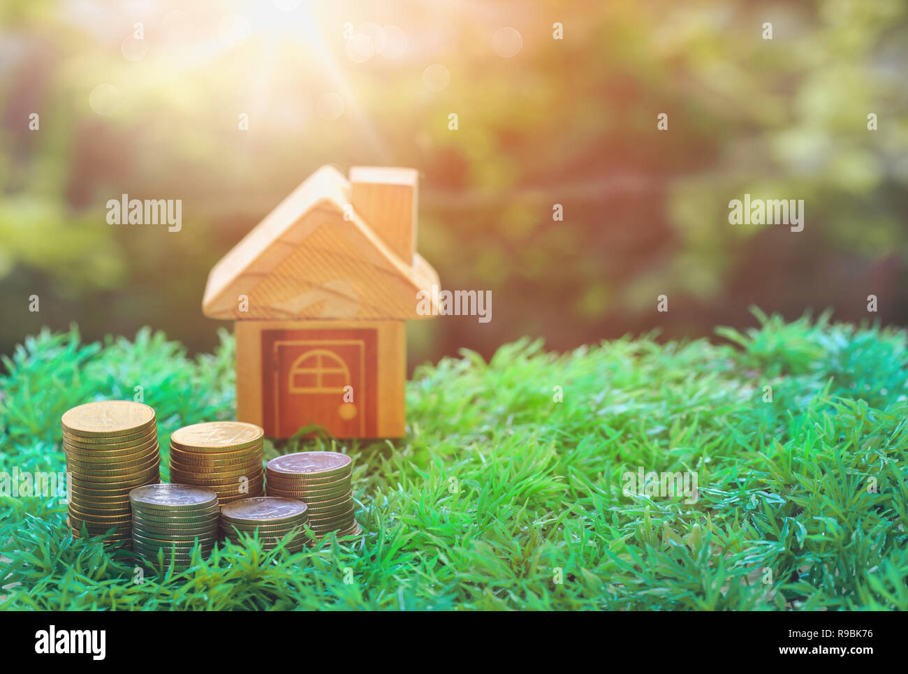 Coins and mock houses are placed in real estate sale or property investment concept, Buying new home for family Stock Photo