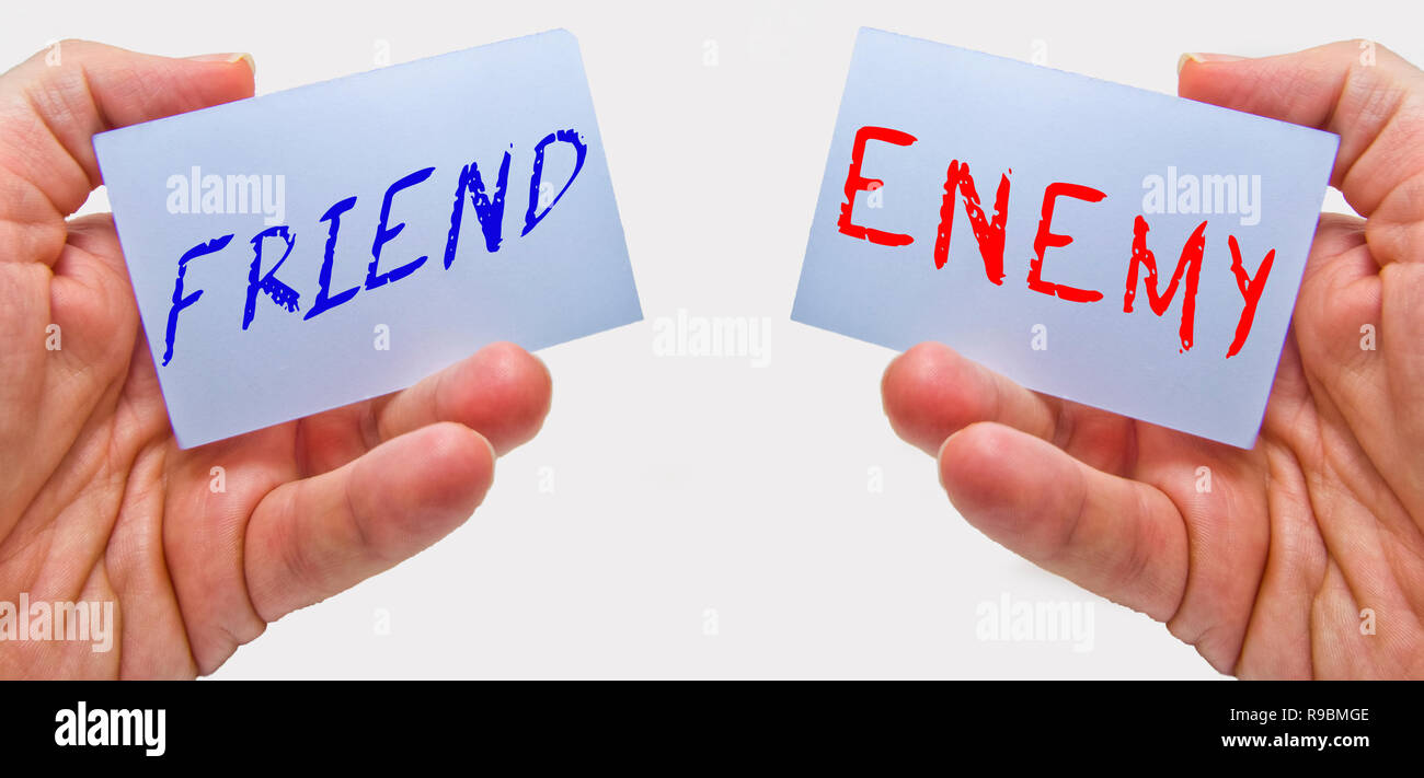 friend and enemy choice cards with man hands on a white background. for business and education concepts - Stock Image