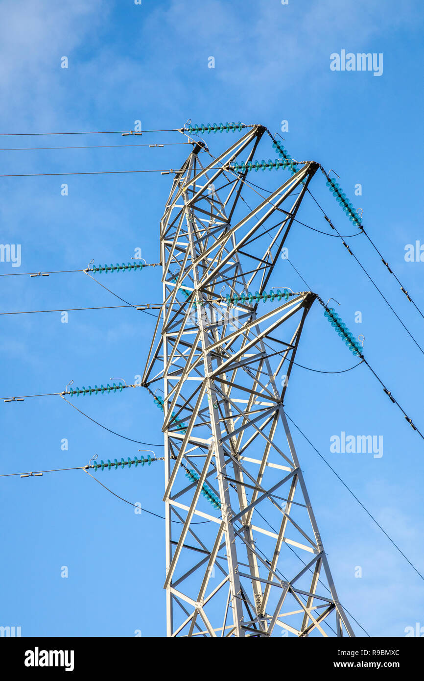 Overhead line power cables and pylons for electrical energy transmission and distribution 11kV, 33kV, 132kV, 275kV, 400kV and HVDC - Stock Image