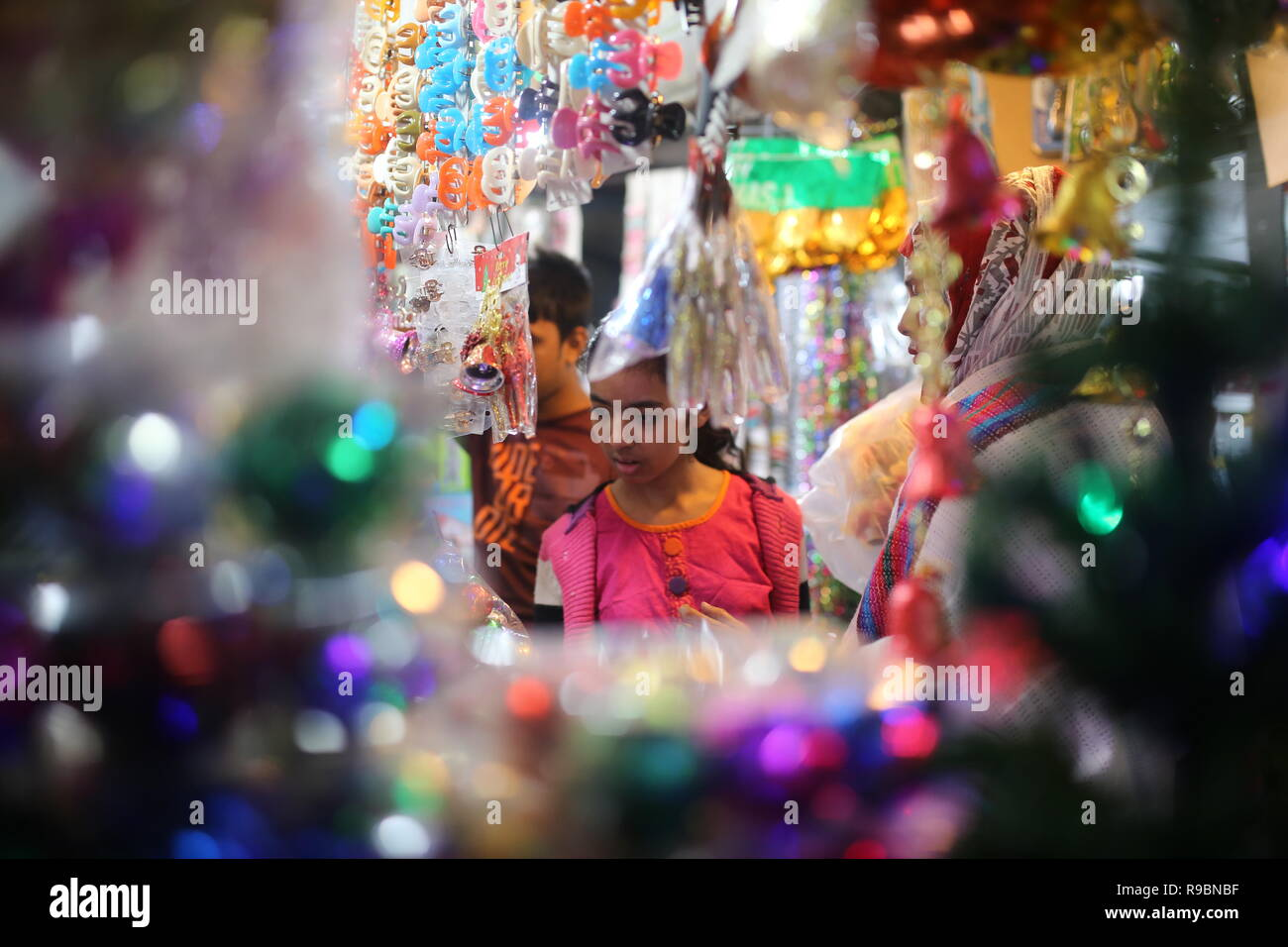 Girl seen Christmas shopping at a store ahead of Christmas Holiday in Dhaka, Bangladesh on December 20, 2018. - Stock Image