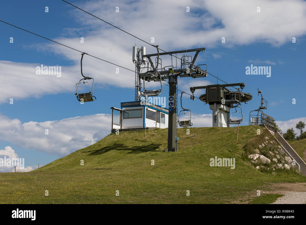 Chairlifts at Alta Badia ski area in the summer, Dolomites, Italy Stock Photo