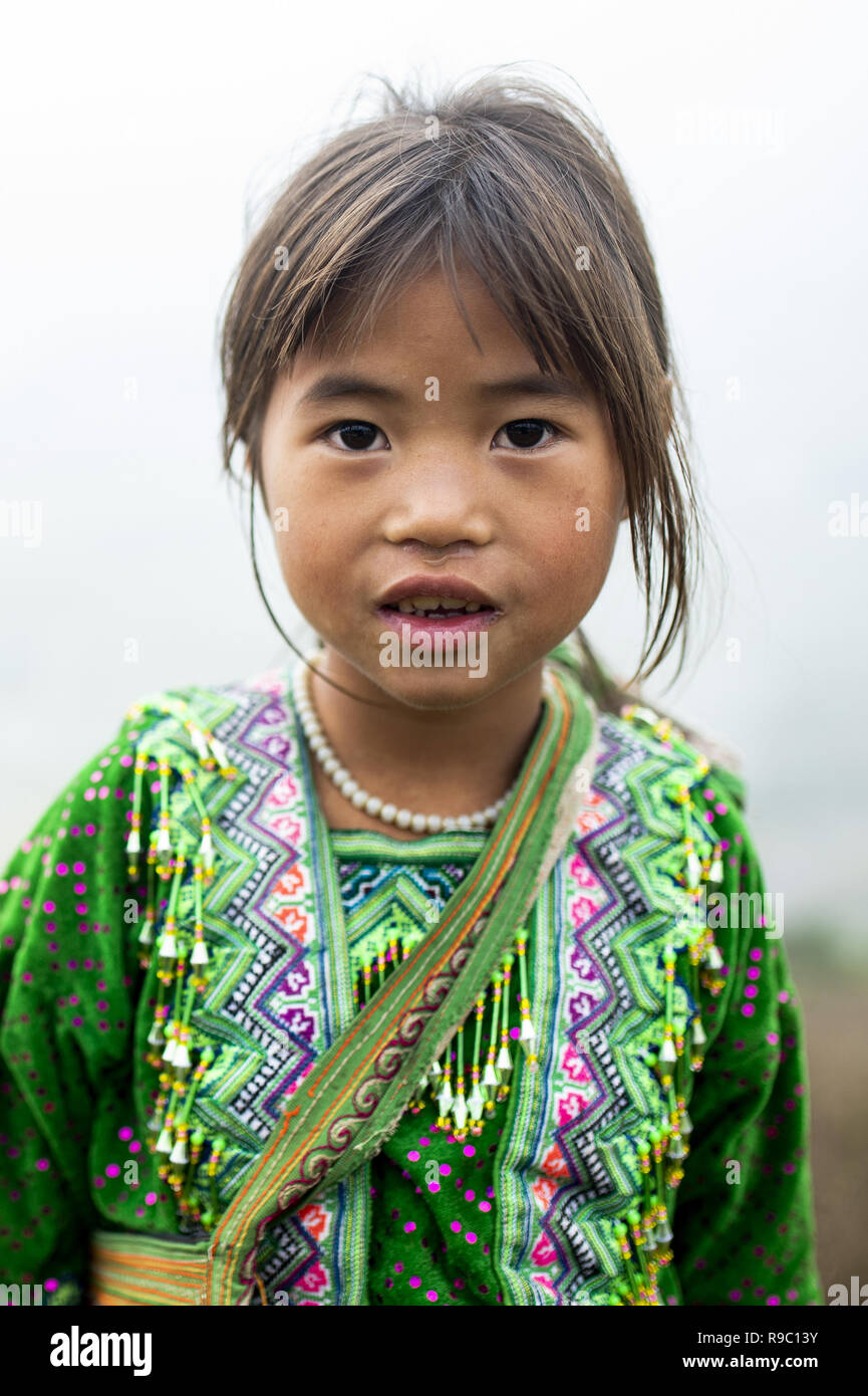 Portrait A girl of Hmong ethnicity with her traditional dress on the hills of the beautiful Sa Pa in Vietnam. - Stock Image