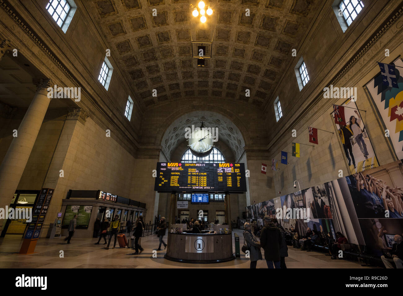 TORONTO, CANADA - NOVEMBER 13, 2018: Toronto main hall with its departures and arrivals board & passengers rushing. It is the main railway station for - Stock Image
