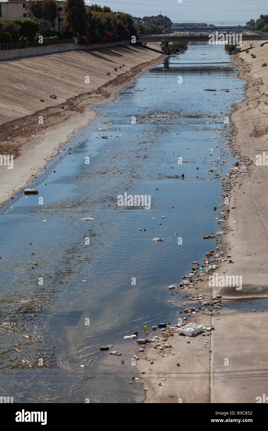 Large amounts of trash and plastic refuse collect in Ballona Creek after first major rain storm of the season. Ballona Creek. Once a meandering creek, - Stock Image